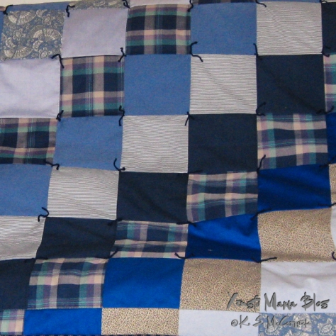 Patchwork quilt in shades of blue.