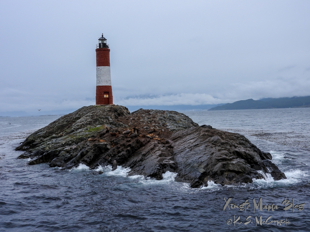 Les Eclairs Lighthouse, and sea lions, on a rocky outcrop in the Beagle Channel in South America.