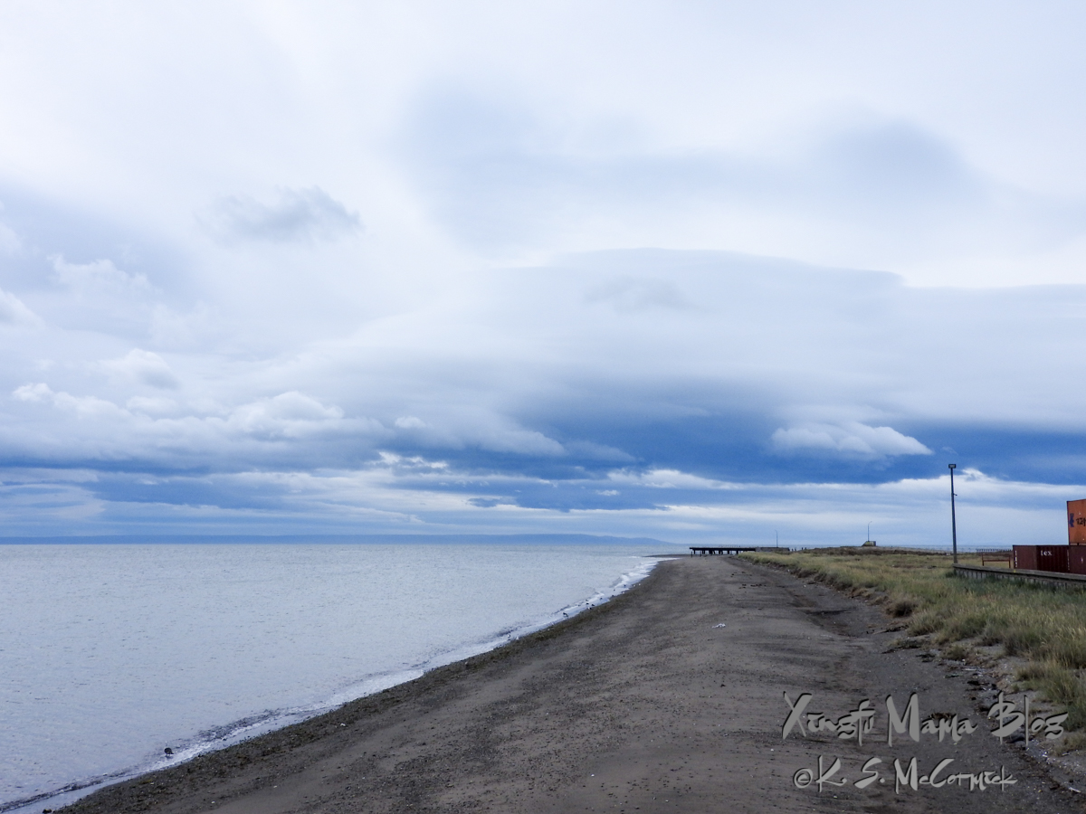 Strait of Magellan and the sandy shore of Punta Arenas in Chile.