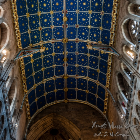 Ceiling of the nave at Carlisle Cathedral. Blue panels decorated with gold stars.
