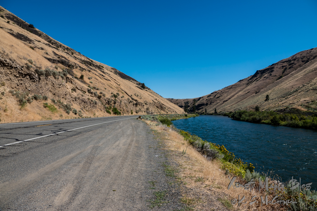 Yakima Canyon road runs beside the very blue Yakima river, but the surrounding hills are very dry.
