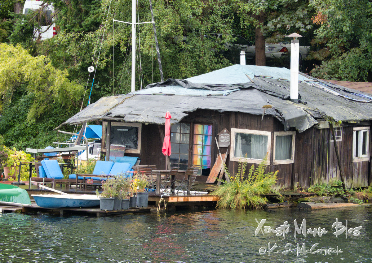 The olest houseboat in Seattle was built as a model of a Yukon shack for an exhibition, but the seating on its deck looks decidedly modern.
