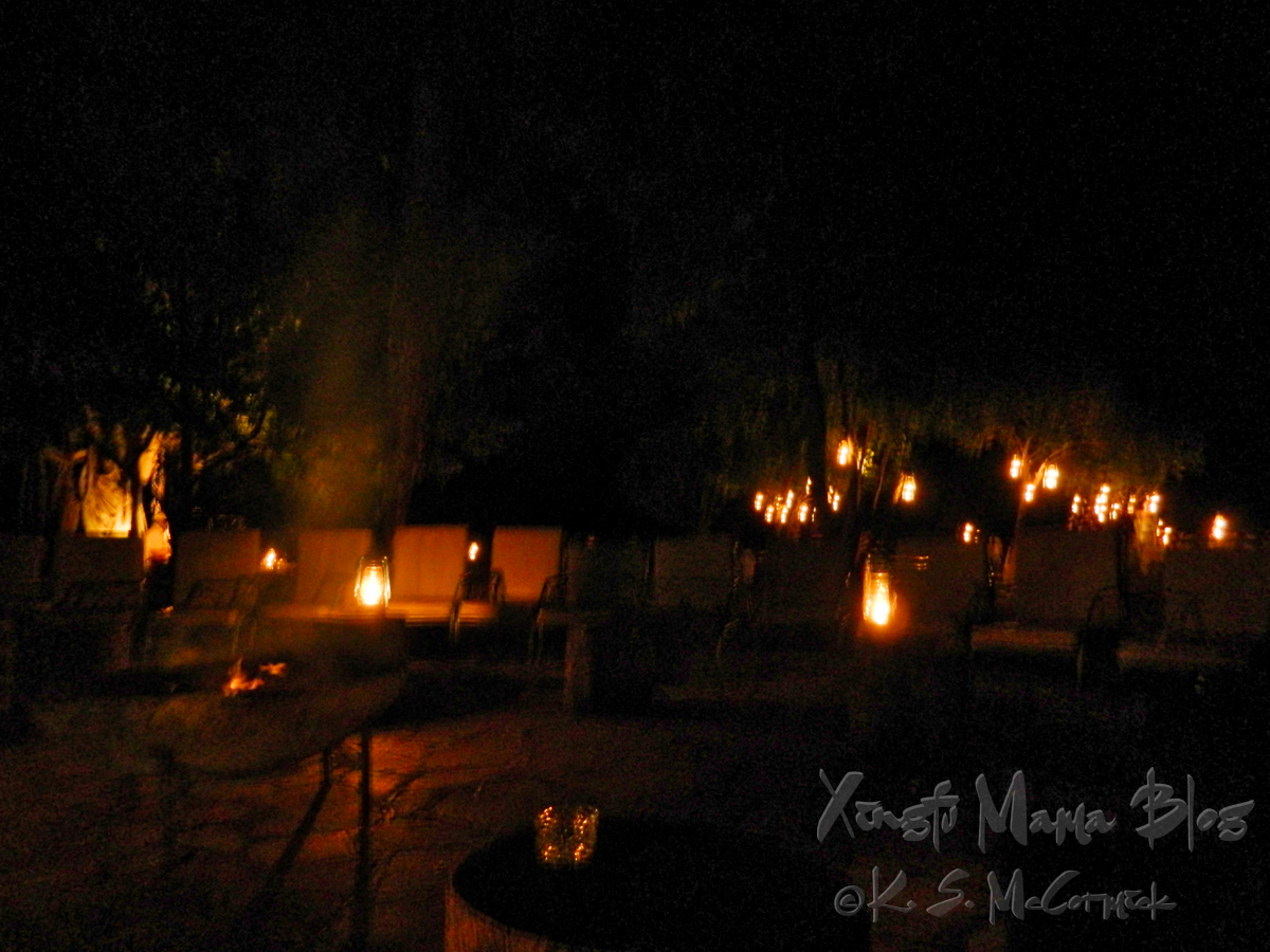 Seating outdoors at Kichwa Tembo was lit by lanterns at night.