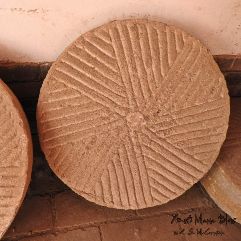 Square image of a millstone at Yangjiabu Folk Village in Weifang, China.