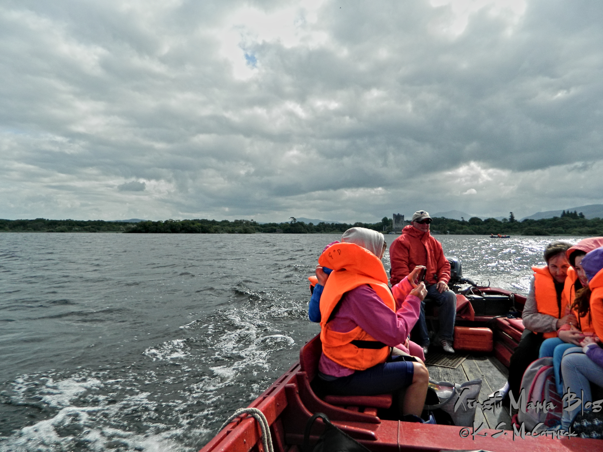 Seats and riders on a boat on Lake Killarney.