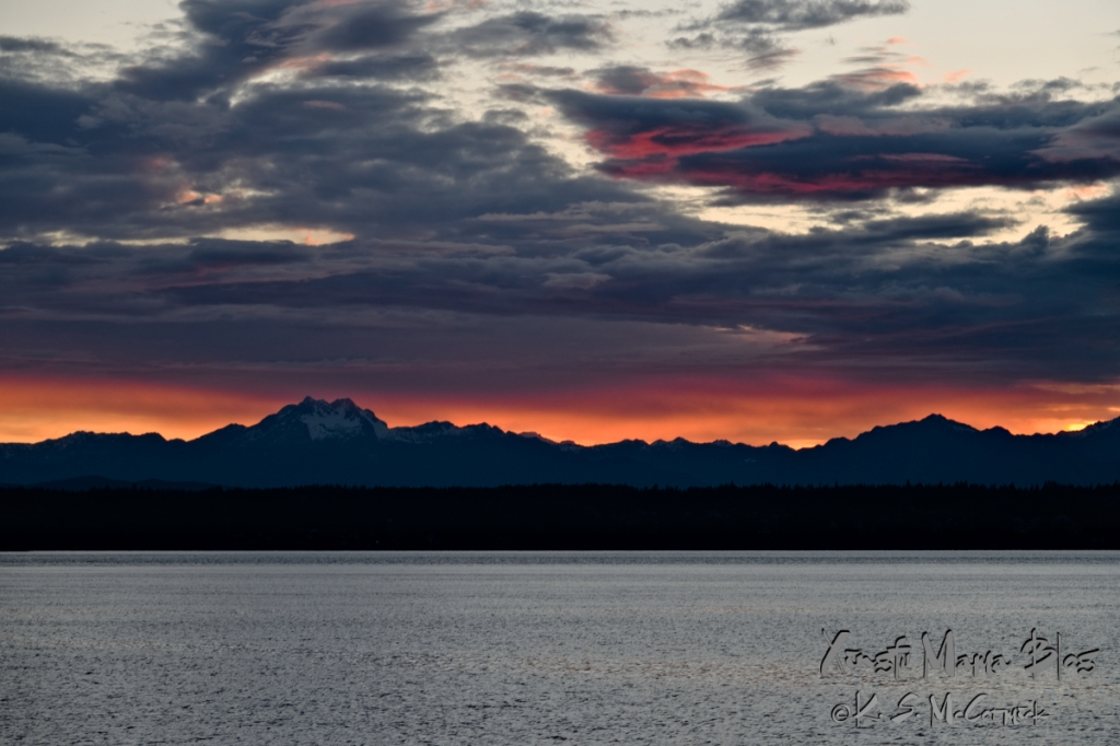 Sunset behind the Olympic Mountains in Washington state.