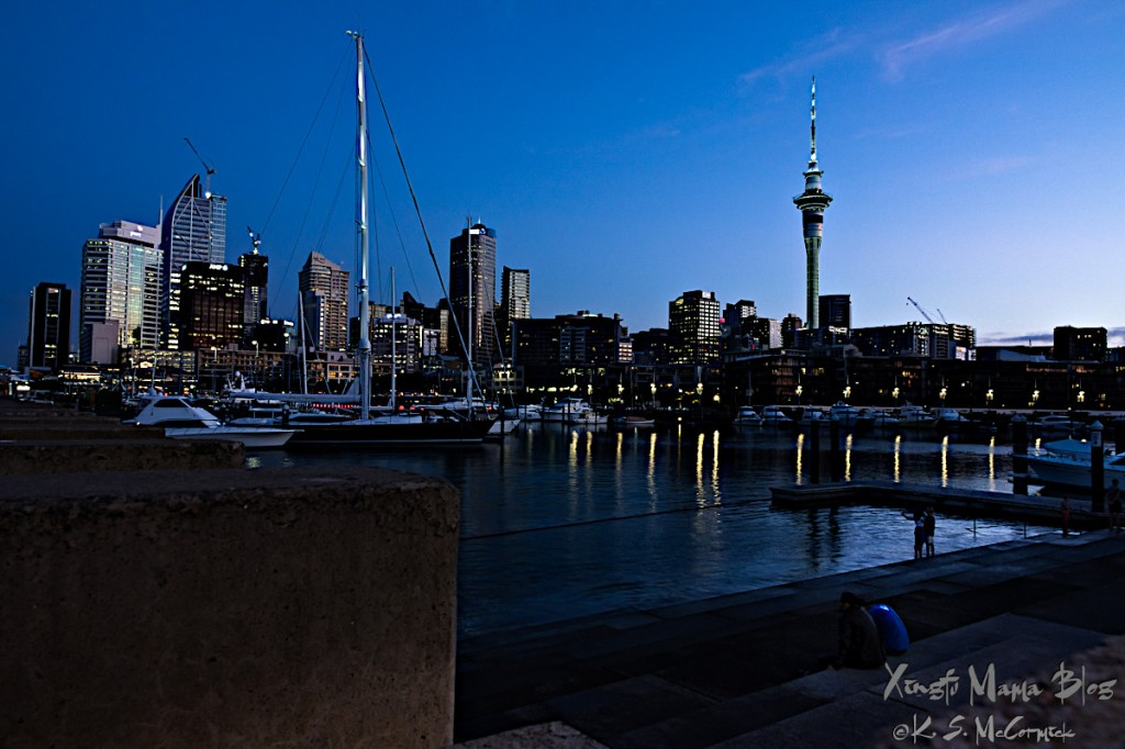 Auckland skyline at dusk, viewed from Wynyard, with the Viaduct basin in the foreground.
