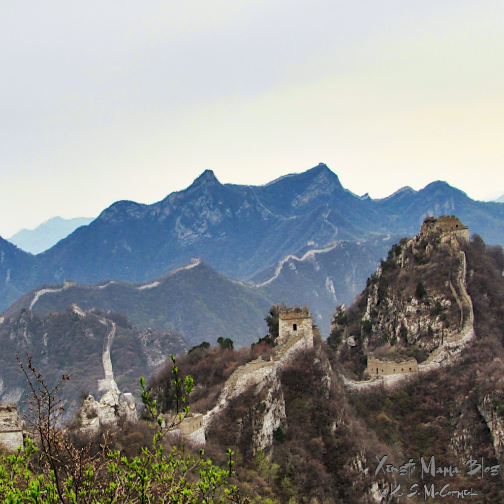 The great wall winds along the top of the mountain ridge heading toward the west.