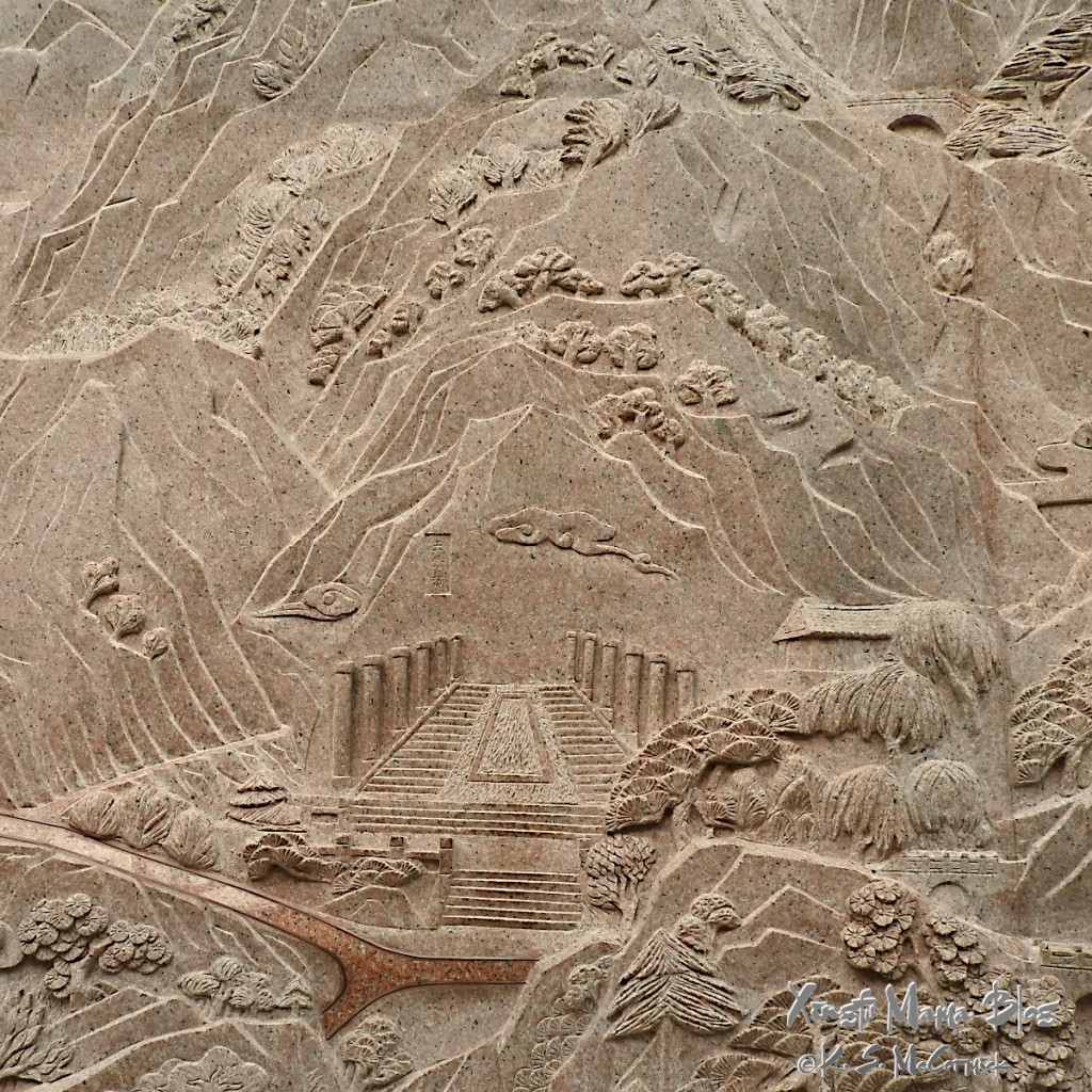 A carved granite mural in an underpass in Tai'an.