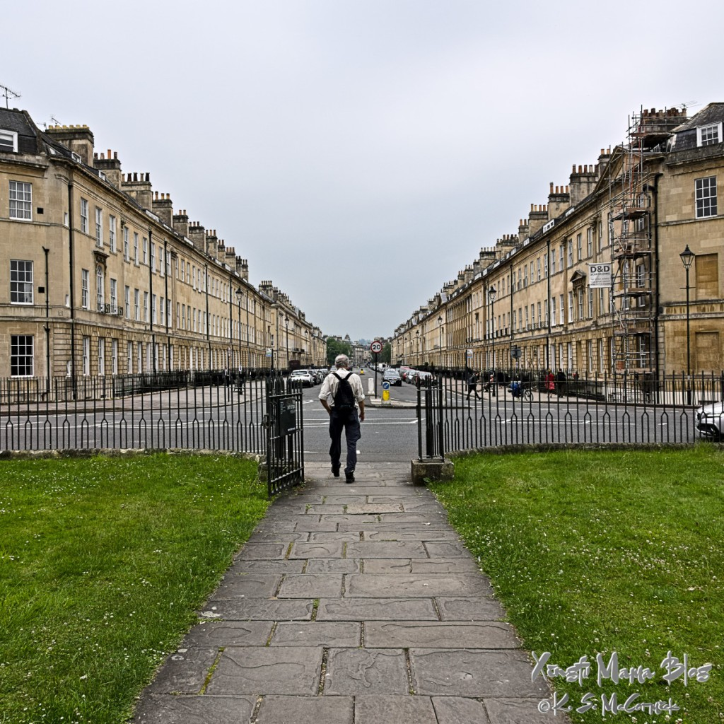 eA view of a man Exiting the Holburne museum facing down Great Pulteney Street, in Bath, England on a cloudy day.