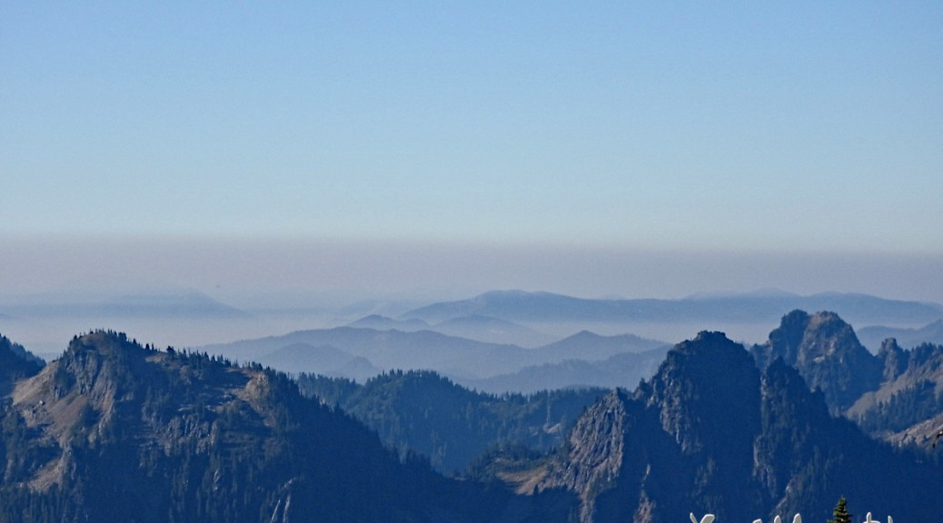 View of the Cascade Mountains with smoke from wildfires.