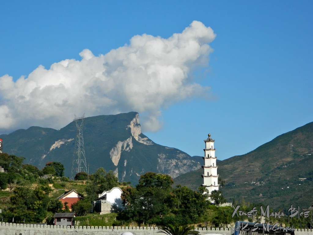 The pagoda of White Emperor City on the Yangtze River with the Wu mountains of the Qu Gorge (western most of the Three Gorges) behind it.