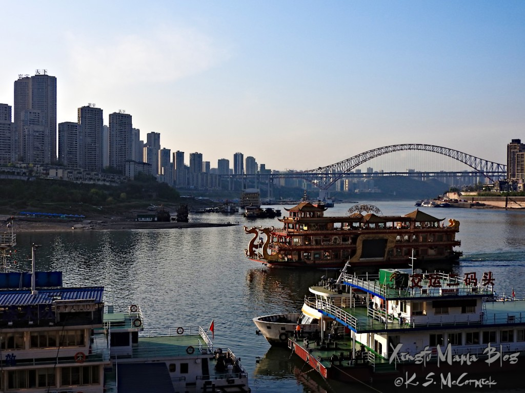 Boats and bridges as well as buildings define the skyline of Chongqing.