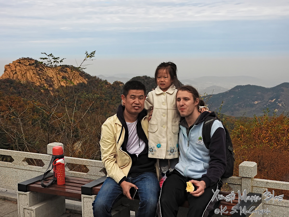 Three people stopping for a snack on Yi Shan (Moutn Yi) in Shandong Province.