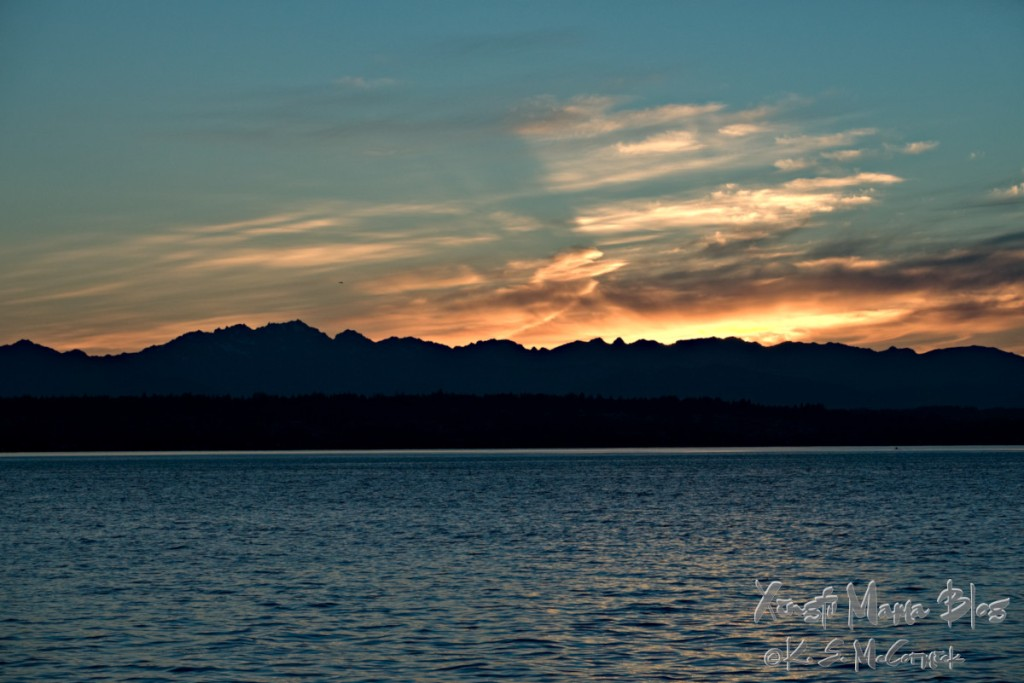 Bright clouds over the Olympic Mountains just after sunset on Puget Sound.