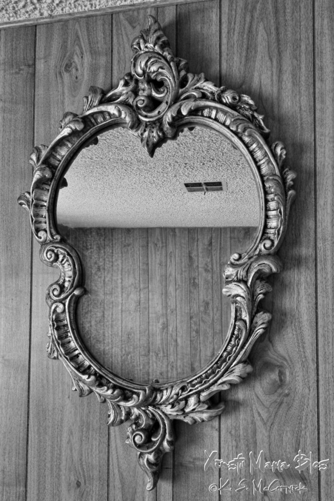 A fancy old mirror seems like it just needs a story to go with it.