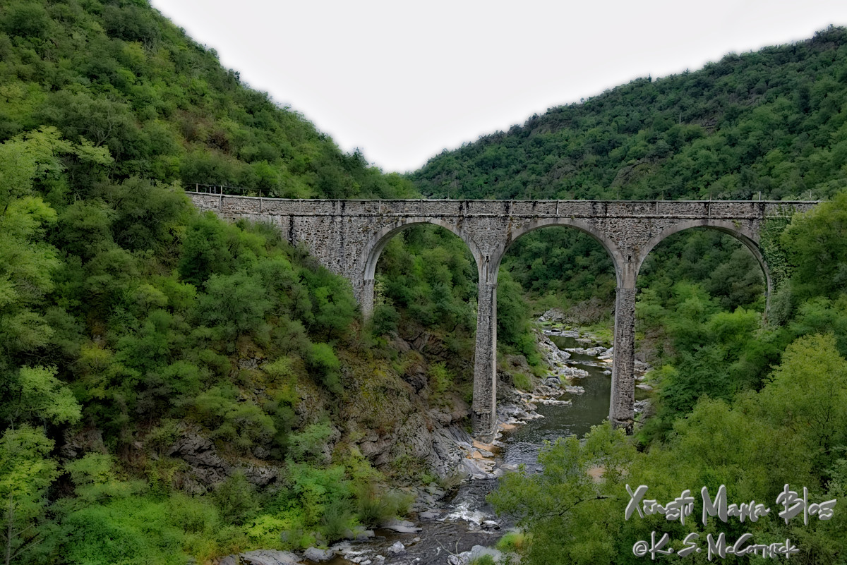Old stone bridge over the Doux River in the Ardeche region of France.